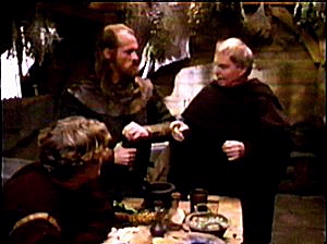 Brother Cadfael discusses the case with Hugh and one of his men.