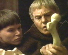 Brother Cadfael and a Novice ponder a bone